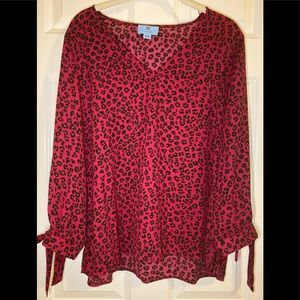 NWT CeCe hi-low blouse with ties on sleeves.